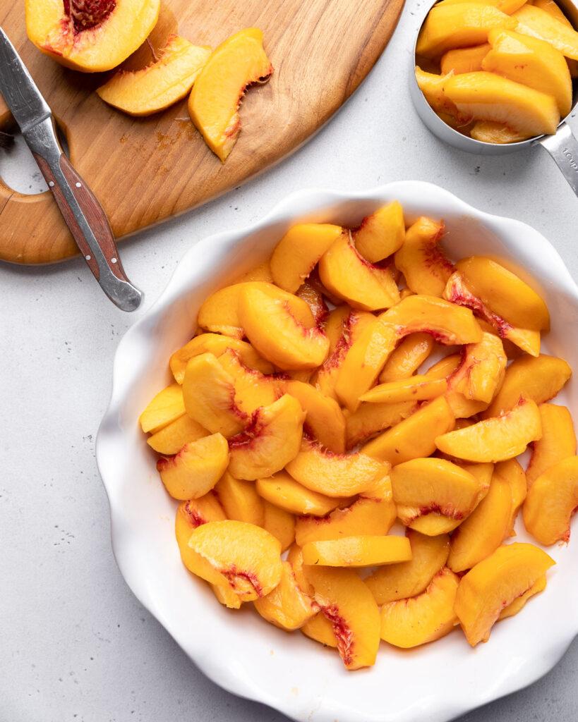 fresh peaches in pie dish
