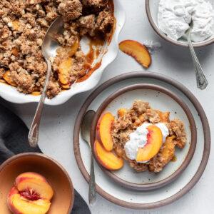 Healthier peach crisp served on plate