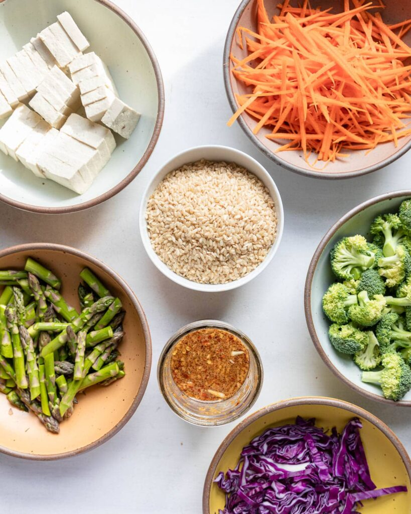ingredients: tofu, brown rice, shredded carrots, broccoli, asparagus, red cabbage, stir fry sauce