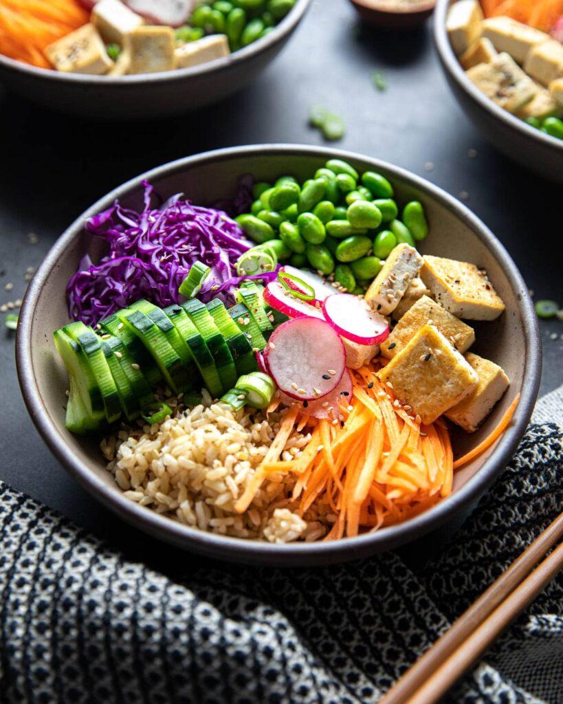 loaded plant-based poke bowl with chopsticks
